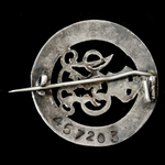 Silver War Badge, reverse numbered: '457203', awarded to Private W.G. Adcock, 1st Battalion, Roya...