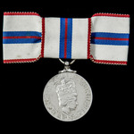 Jubilee Medal 1977, mounted on ladies issue bow ribbon, housed in its original Royal Mint box of ...