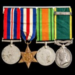 Second World War North West Europe and Territorial long service group awarded to Gunner C. Robson...