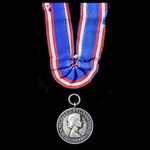   Royal Victorian Medal in Silver, EIIR bust, unnamed as issued, and with remnants of ribbon ind...