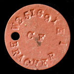 ​A Second World War identity disc, as worn by a woman, I.E. Bracher (No.W251691).