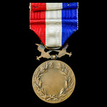 France: Honour medal of Foreign Affairs in Bronze, Wartime issue with Crossed Swords. As awarded ...