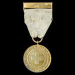 A British Red Cross Society War Service Medal 1914-1918, complete with top brooch bar, unnamed as...