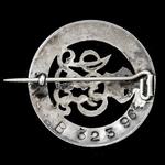 Silver War Badge, reverse numbered: 'B323964', as awarded to Sapper P.W. Smith, Royal Engineers, ...