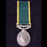 GviR EFFICIENCY MEDAL Bar 'TERRITORIAL' to SJT CLARKE who served with a Light Anti Aircraft Batte...